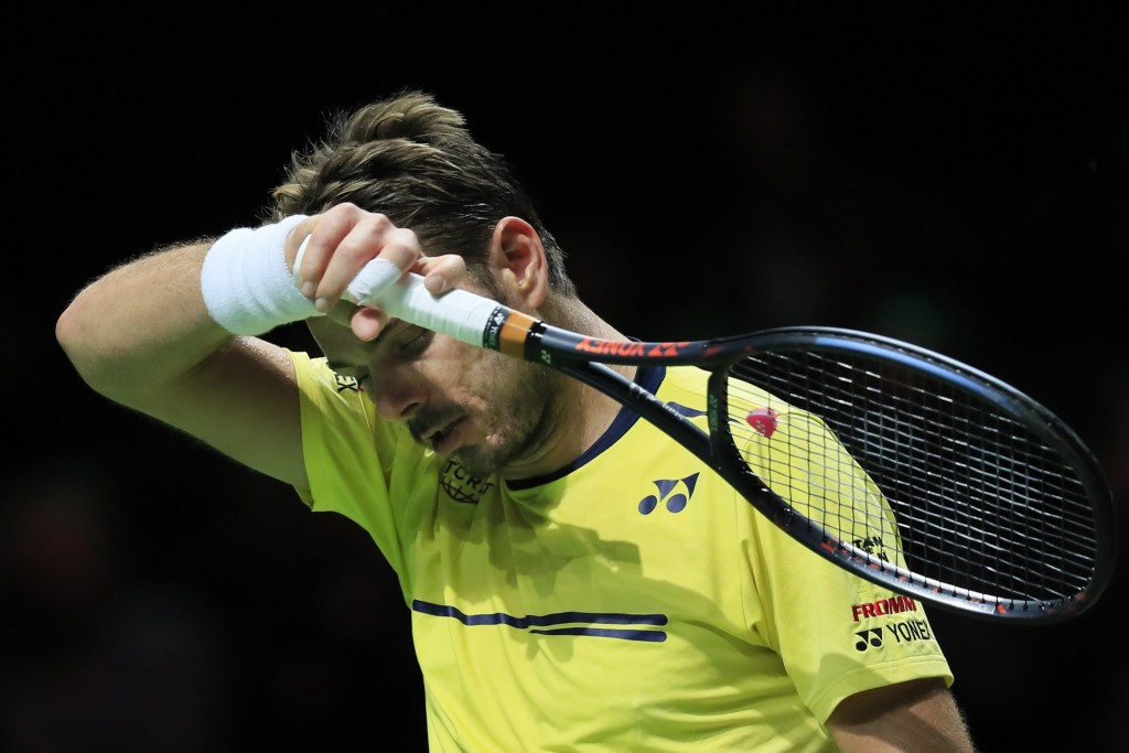 Stan Wawrinka of Switzerland wipes the sweat off his face in his match against Gael Monfils of France in the men's singles final of the ABN AMRO world...