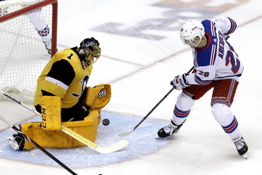 New York Rangers' Chris Kreider (20) cannot get a rebound past Pittsburgh Penguins goaltender Casey DeSmith (1) during the first period of an NHL hock...