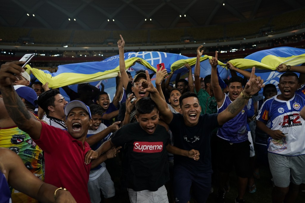 Alvorada fans invade the pitch to celebrate after their team won the main category of the Peladao amateur soccer tournament final at Arena da Amazonia...
