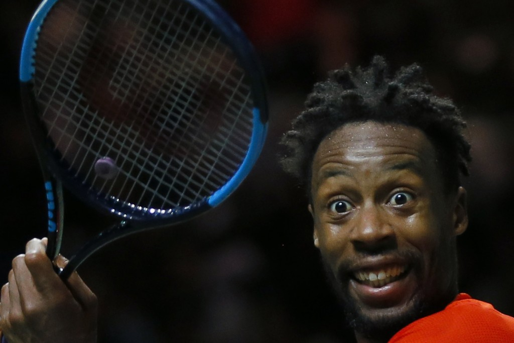 Gael Monfils of France mimics to his coach after scoring a point against Stan Wawrinka of Switzerland in the men's singles final of the ABN AMRO world...