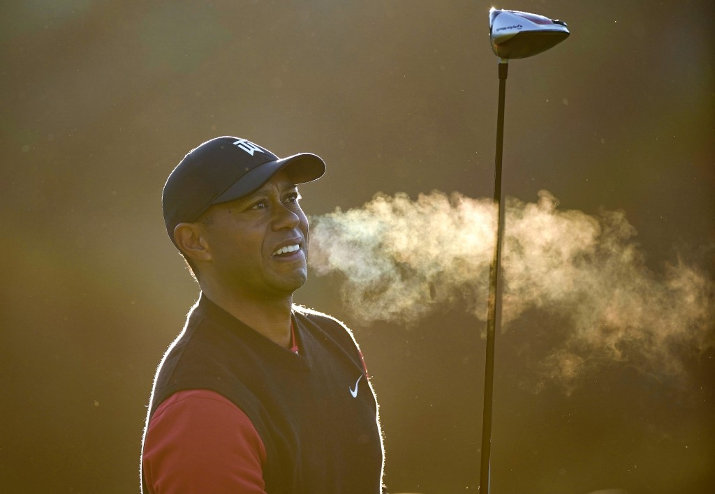 Tiger Woods exhales after hitting his tee shot on the second hole as third-round play continues during the Genesis Open golf tournament at Riviera Cou...