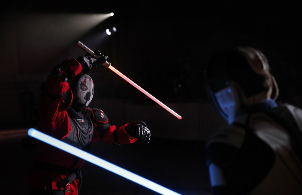 In this Sunday, Feb. 10, 2019, photo, Julien Esprit, left, competes with Jean Baptiste Marchetti-Waternaux during a national lightsaber tournament in