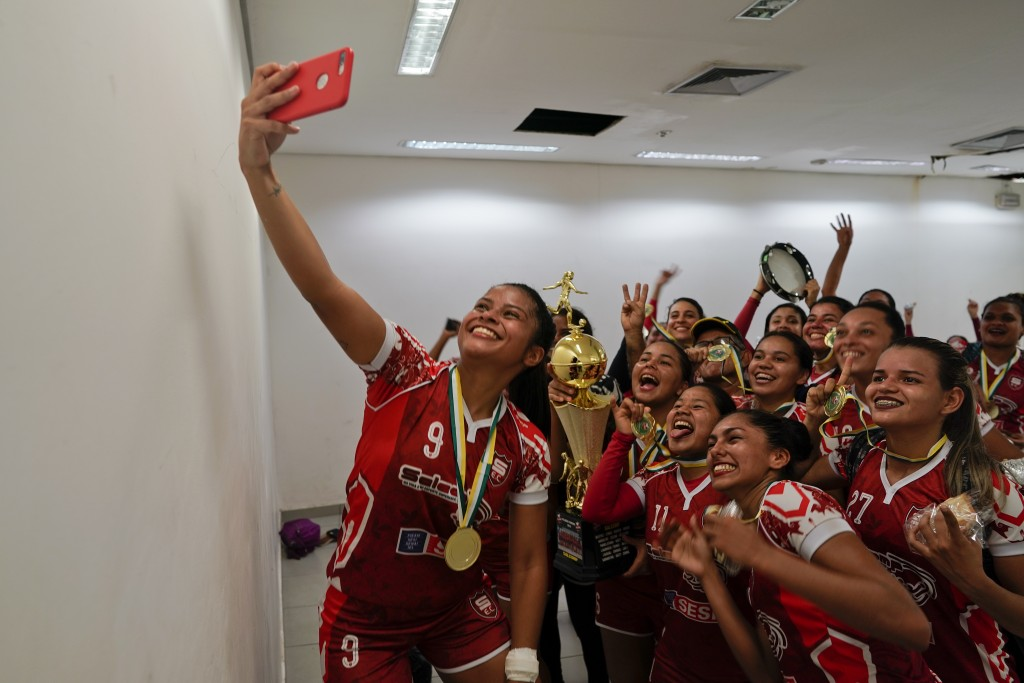 Salcomp soccer players take a selfie in the dressing room after winning the Peladao amateur soccer tournament at Arena da Amazonia in Manaus, Brazil, ...