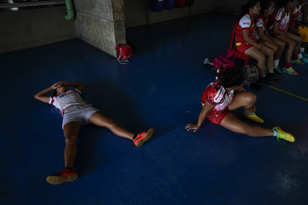 Salcomp soccer players rest after a training session in Manaus, Brazil, Thursday, Feb. 14, 2019. The players normally commute for one or two hours bef...