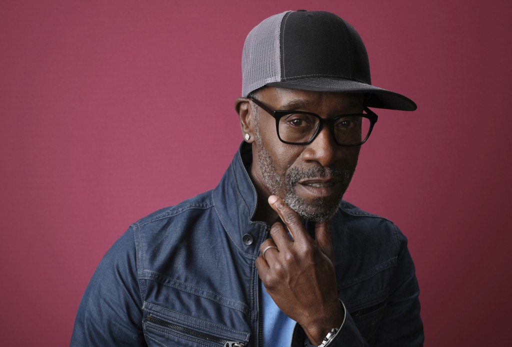 """FILE- In this Jan. 31, 2019, file photo Don Cheadle, a cast member in the Showtime series """"Black Monday,"""" poses for a portrait during the 2019 Winter ..."""