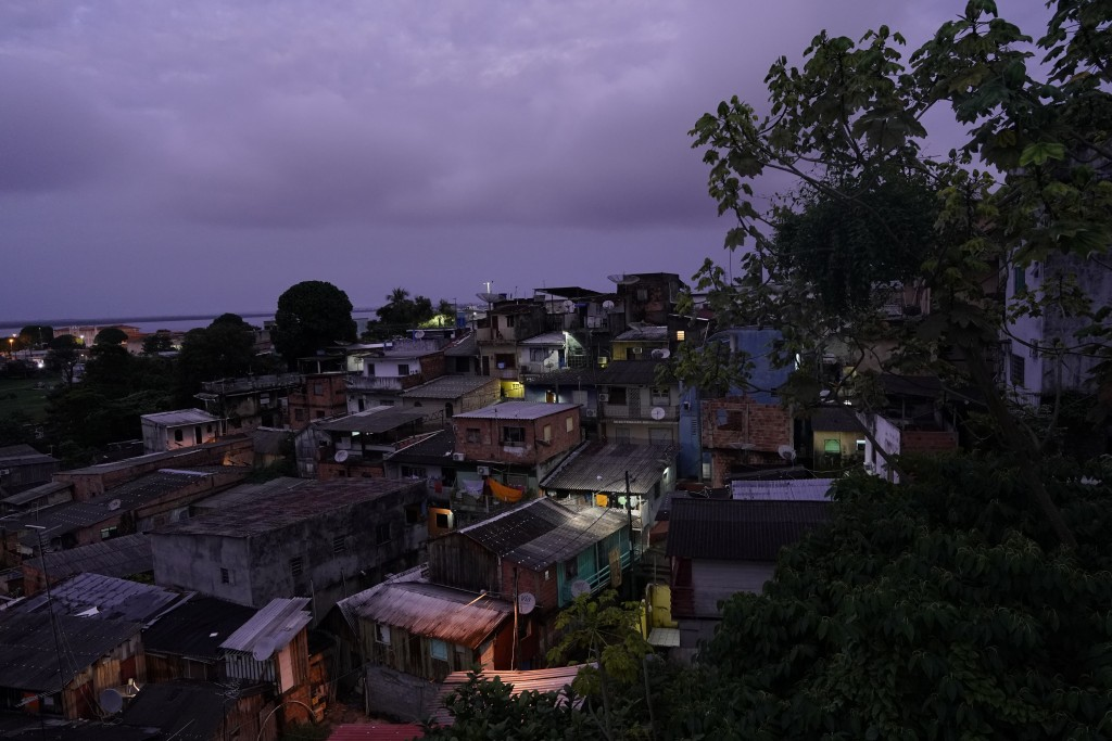 The sun rises over a neighborhood in Manaus, Brazil, Saturday, Feb. 16, 2019. The largest city in Brazil's Amazon region hosted the annual gigantic Am...
