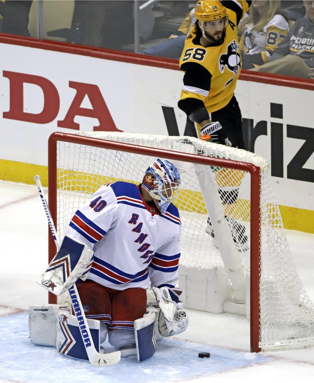 Pittsburgh Penguins' Kris Letang (58) celebrates his goal against New York Rangers' Alexandar Georgiev (40) during the first period of an NHL hockey g...