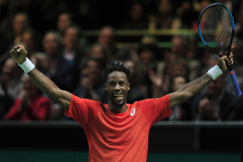 Gael Monfils of France celebrates winning against Stan Wawrinka of Switzerland in sets, 6-3, 1-6, 6-2, in the men's singles final of the ABN AMRO worl...