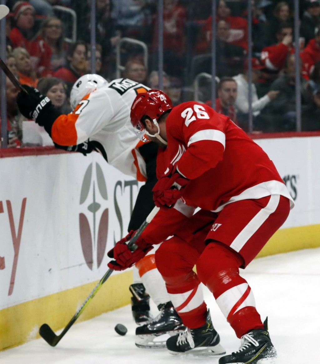 Philadelphia Flyers defenseman Andrew MacDonald (47) and Detroit Red Wings left wing Thomas Vanek (26) fight for the puck during the second period of ...