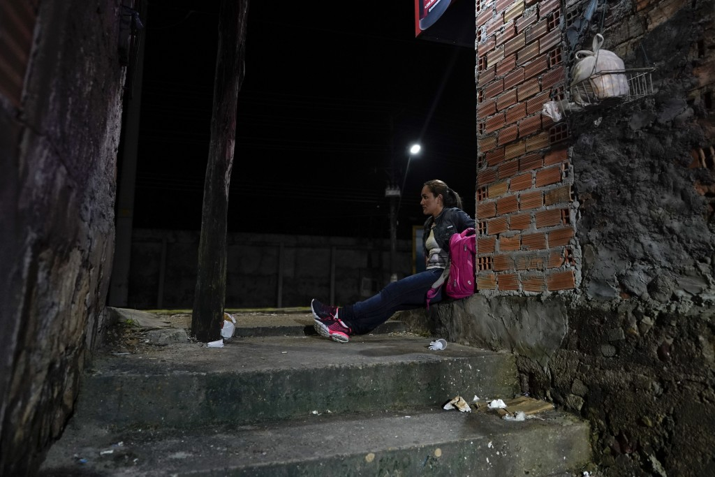 Salcomp soccer striker Suzy Carvalho waits for the bus to go to work in Manaus, Brazil, Saturday, Feb. 16, 2019. Before Carvalho steps on to the pitch...