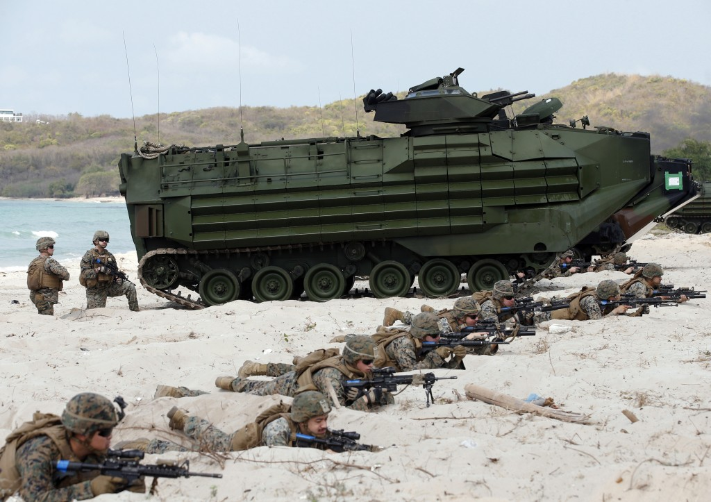 FILE - In this Feb. 16, 2019, file photo, U.S. soldiers land with an amphibious assault vehicle and secure the beach head during the ongoing U.S.-Thai...