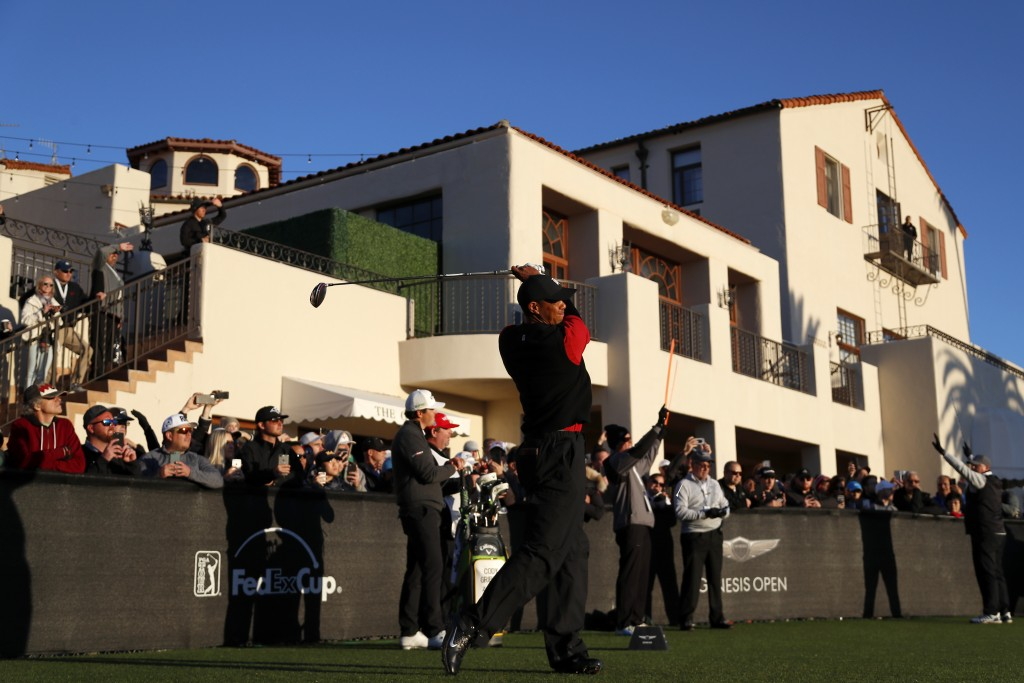 Tiger Woods tees off on the first hole as third-round play continues during the Genesis Open golf tournament at Riviera Country Club on Sunday, Feb. 1...