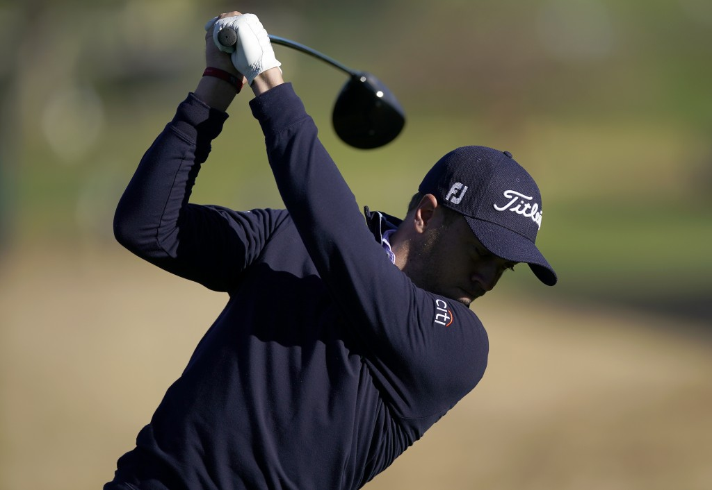 Justin Thomas tees off on the ninth hole as third round play continues during the Genesis Open golf tournament at Riviera Country Club on Sunday, Feb....