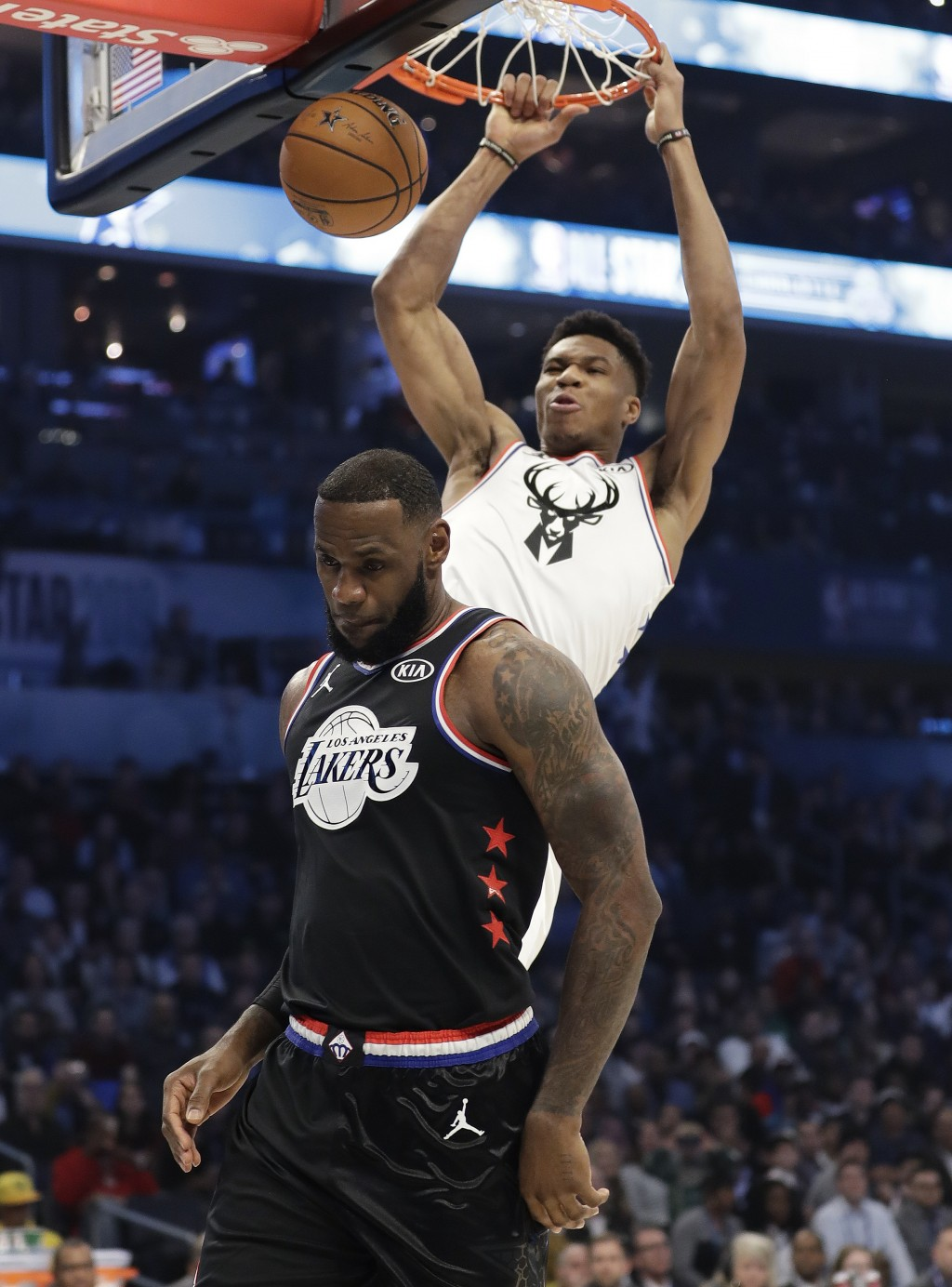 CORRECTS TO THE LAKERS, NOT THE CAVALIERS - Team Giannis' Giannis Antetokounmpo, of the Milwaukee Bucks, dunks the ball against Team LeBron's LeBron J