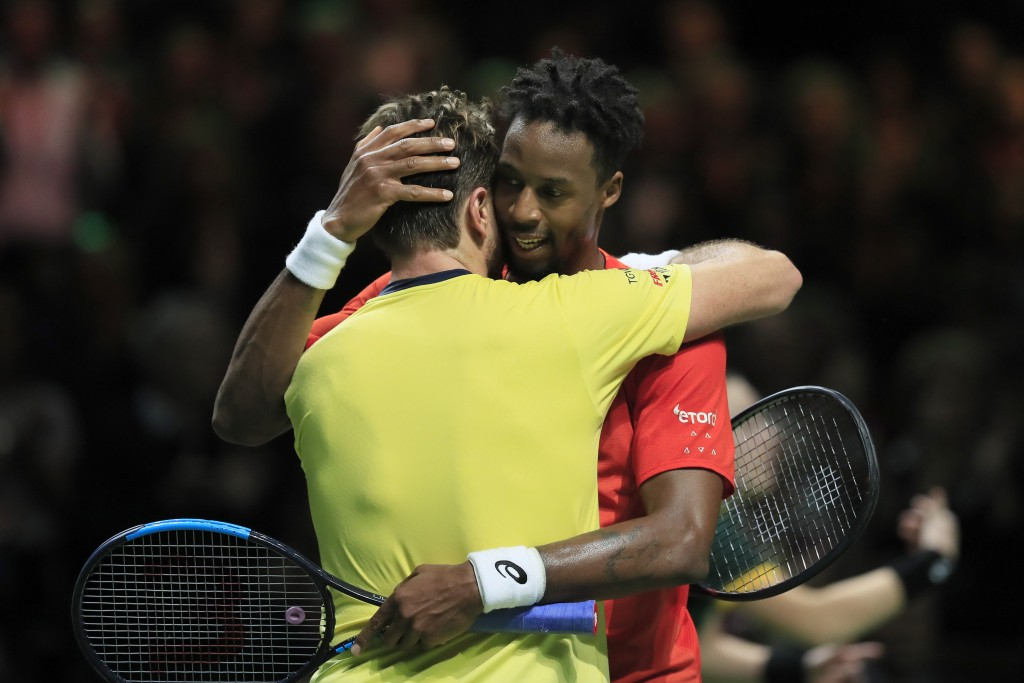 Gael Monfils of France, right, hugs Stan Wawrinka of Switzerland after winning in three sets, 6-3, 1-6, 6-2, in the men's singles final of the ABN AMR...