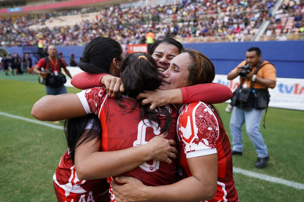 Salcomp striker Suzy Carvalho, right, cries with teammates after winning the Peladao amateur soccer tournament at Arena da Amazonia in Manaus, Brazil,...