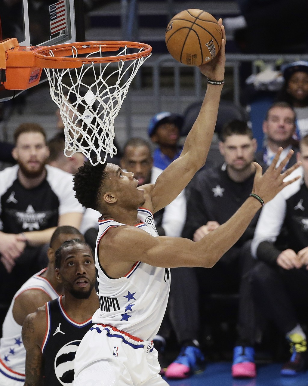 Team Giannis' Giannis Antetokounmpo, of the Milwaukee Bucks dunks against Team LeBron during of the first half of an NBA All-Star basketball game, Sun