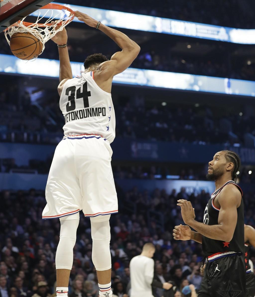 Team Giannis' Giannis Antetokounmpo, of the Milwaukee Bucks, dunks the ball against Team LeBron during the first half of an NBA All-Star basketball ga