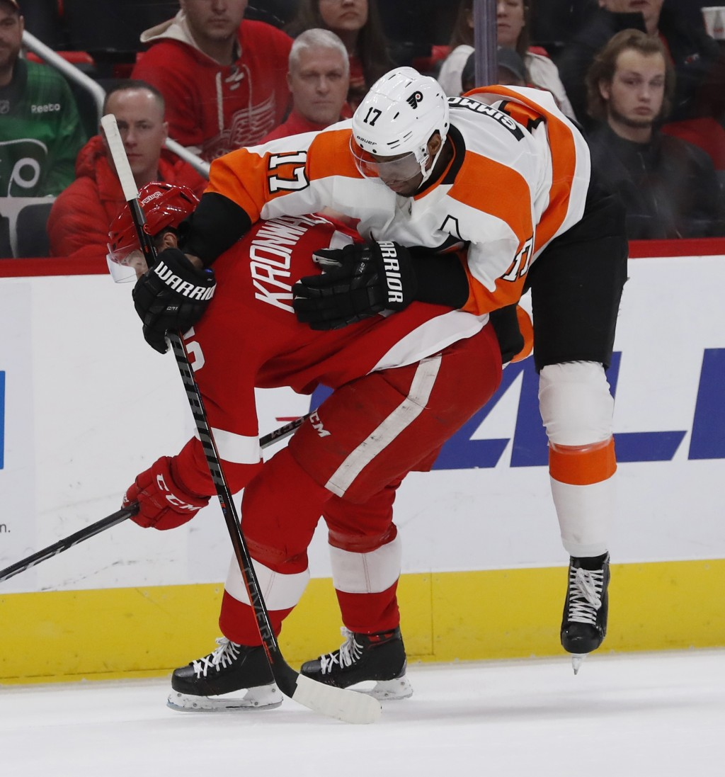 Philadelphia Flyers right wing Wayne Simmonds (17) runs into Detroit Red Wings defenseman Niklas Kronwall (55) during the first period of an NHL hocke