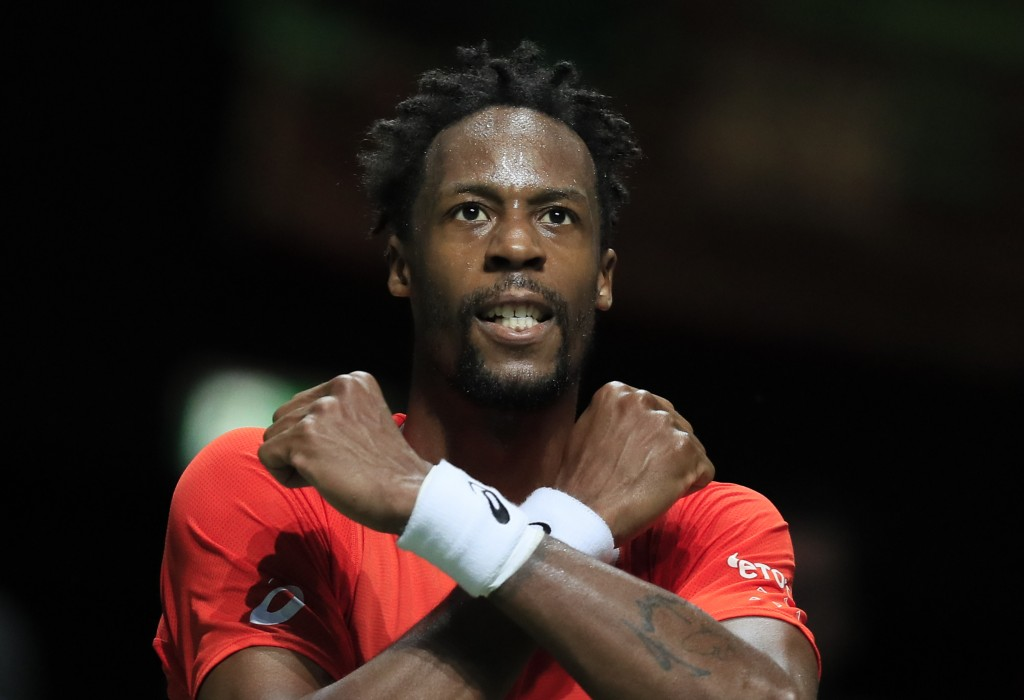 Gael Monfils of France celebrates winning against Stan Wawrinka of Switzerland in three sets, 6-3, 1-6, 6-2, in the men's singles final of the ABN AMR...