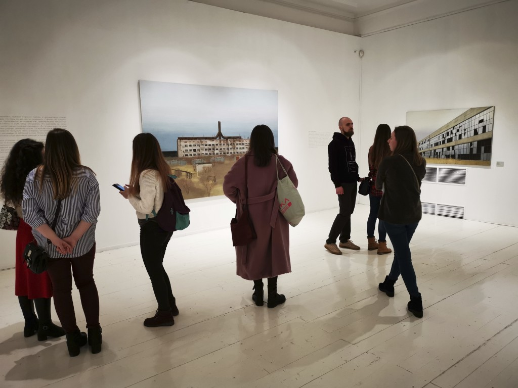 In this photo taken on Sunday, Feb. 17, 2019, visitors attend an exhibition by Russian artist Pavel Otdelnov in Moscow, Russia . Pavel Otdelnov, a Rus...