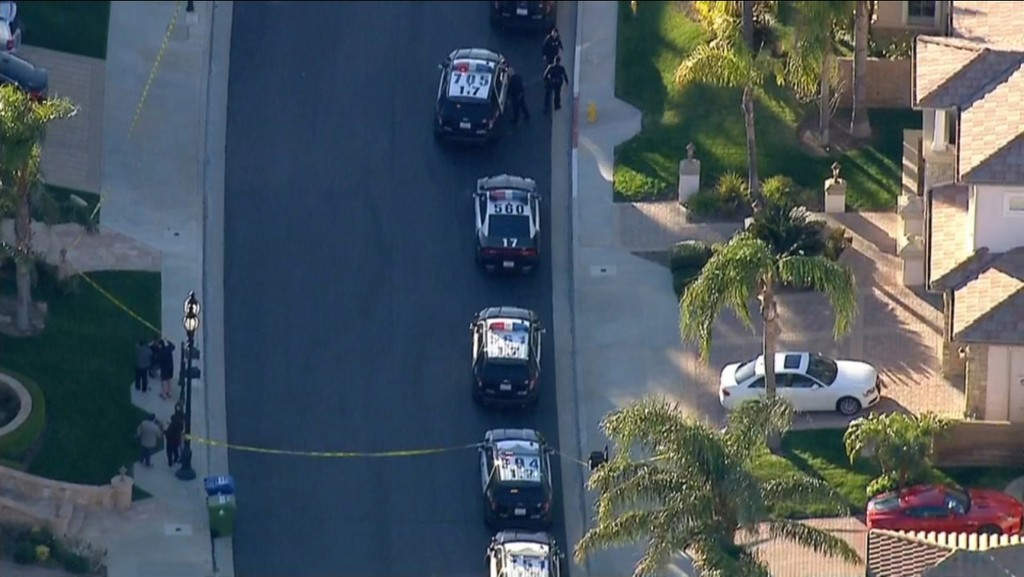 In this still image taken from aerial video provided by KABC-TV, Los Angeles police officers secure a residence in Porter Ranch, northwest of Los Ange...