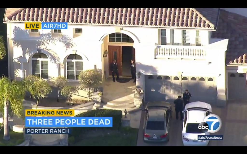 In this still image taken from Live Air7HD aerial video courtesy of KABC-TV, Los Angeles police officers secure a residence in Porter Ranch, northwest