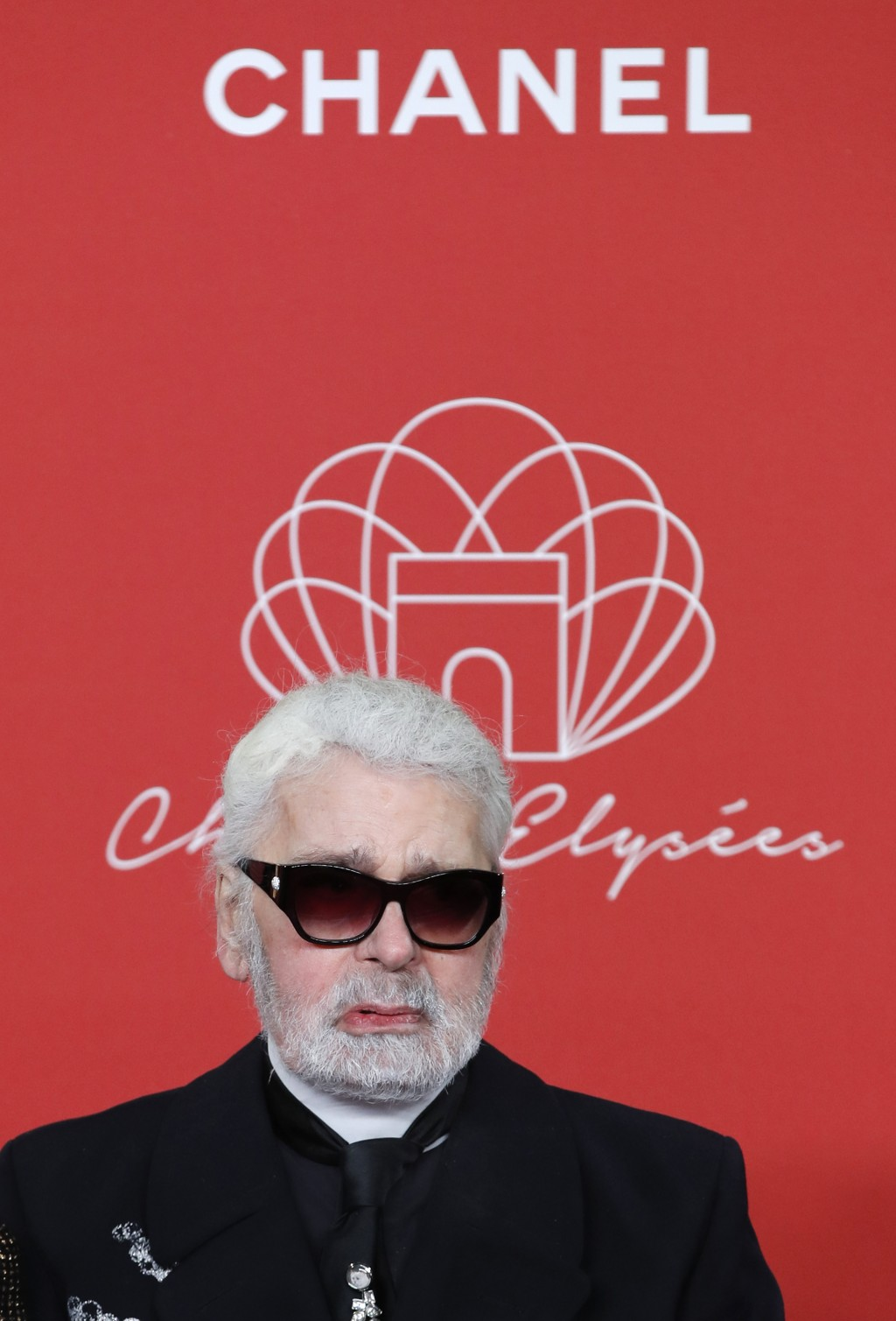 FILE - In this hursday, Nov. 22, 2018 file photo, Karl Lagerfeld poses during the Champs Elysee Avenue illumination ceremony for the Christmas season,