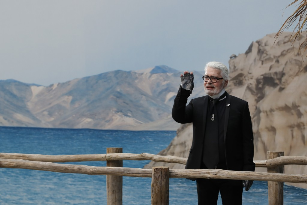 FILE - In this Tuesday, Oct.2, 2018 file photo, Karl Lagerfeld waves after the presentation of Chanel Spring/Summer 2019 ready-to-wear fashion collect...