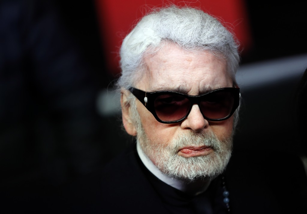 FILE - In this Thursday, Nov. 22, 2018 file photo, Fashion designer Karl Lagerfeld poses during the Champs Elysee Avenue illumination ceremony for the...