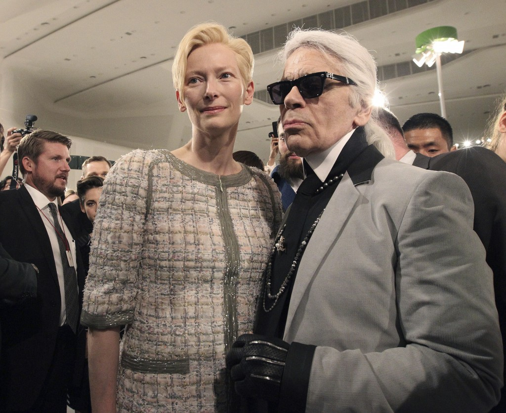 FILE - In this Monday, May 4, 2015 file photo, Karl Lagerfeld, right, poses with British actress Tilda Swinton after the presentation of his 2015-2016