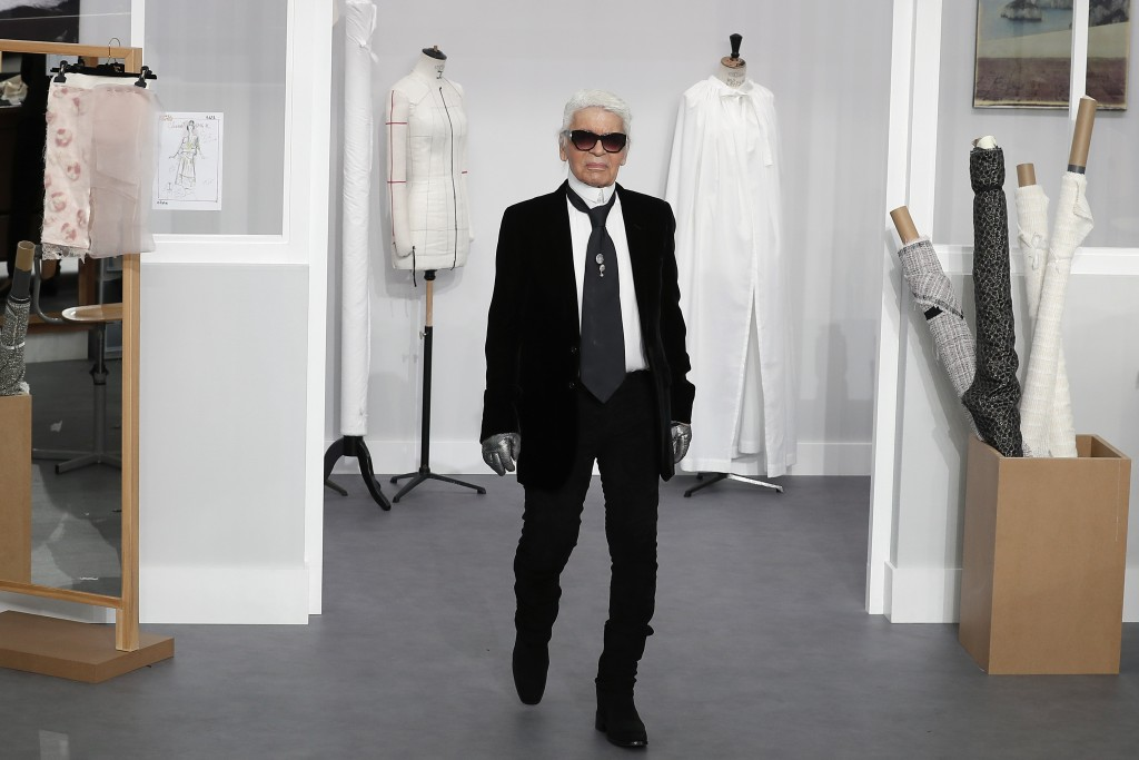 FILE - In this Tuesday, July 5, 2016 file photo, Karl Lagerfeld arrives at the end of Chanel's Haute Couture Fall-Winter 2016-2017 fashion collection