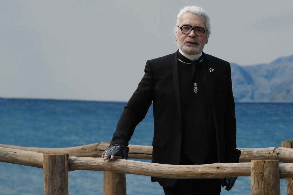 FILE  - In this Tuesday, Oct.2, 2018 file photo, fashion designer Karl Lagerfeld poses after the presentation of Chanel Spring/Summer 2019 ready-to-we