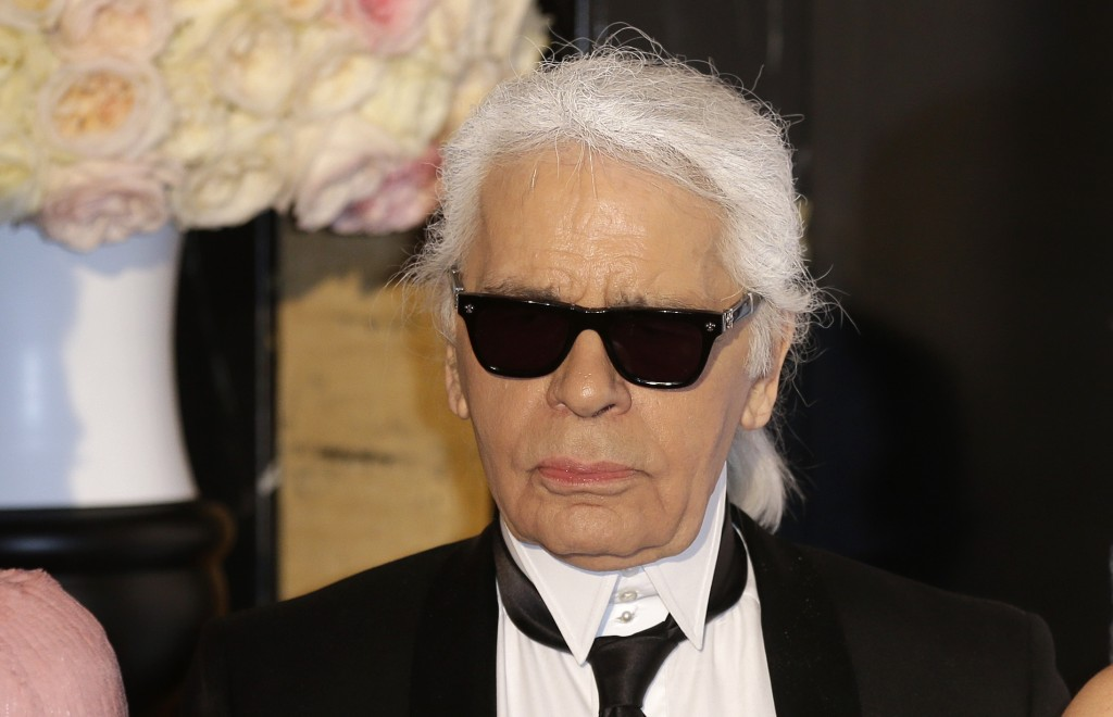 FILE - In this Saturday, March 28, 2015 file photo, Karl Lagerfeld poses for photographers as he arrives at the Rose Ball in Monaco. The Rose Ball is ...
