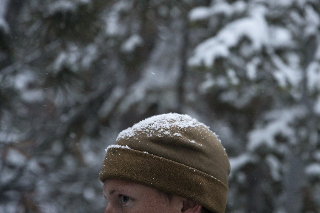 2nd Lt. Brendan Dixon, of Hampton Roads, Va., listens to Col. Kevin Hutchison during advanced cold-weather training at the Marine Corps Mountain Warfa...