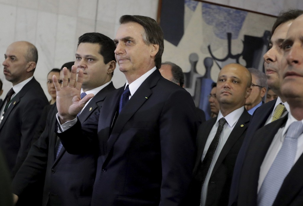 Brazil's President Jair Bolsonaro, center, arrives at the National Congress to deliver a proposal to overhaul Brazil's pension system, in Brasilia, Br