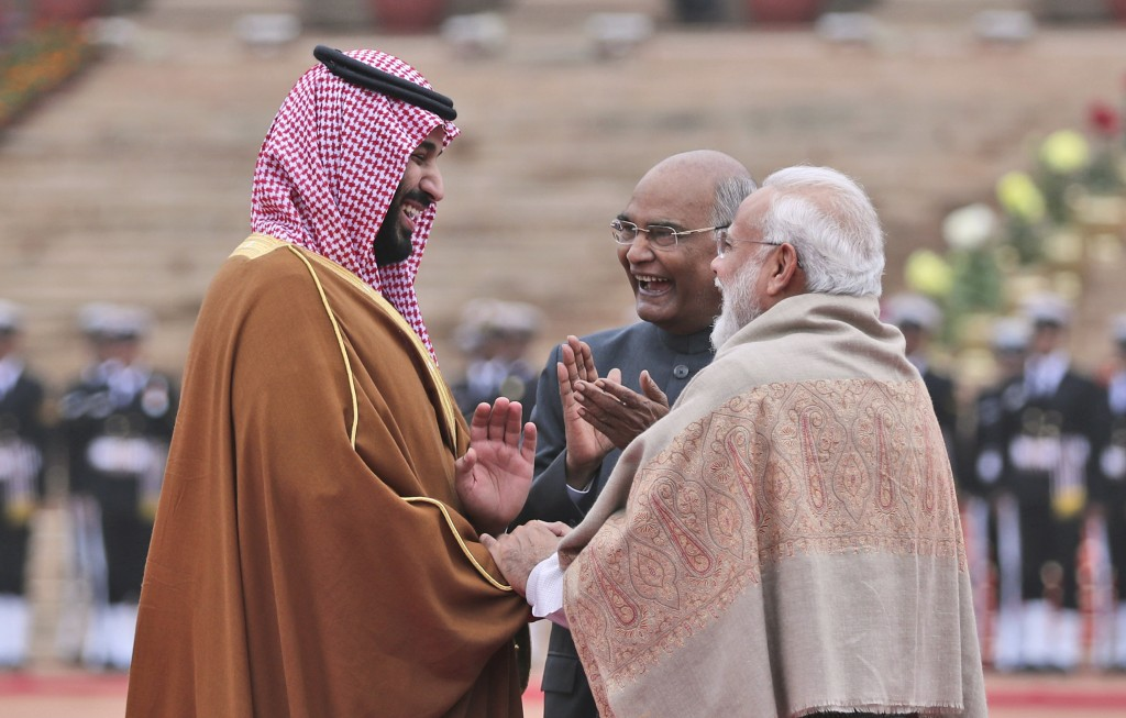 Saudi Arabia's Crown Prince Mohammed bin Salman interacts with Indian Prime Minister Narendra Modi, right, and President Ram Nath Kovind during a cere...