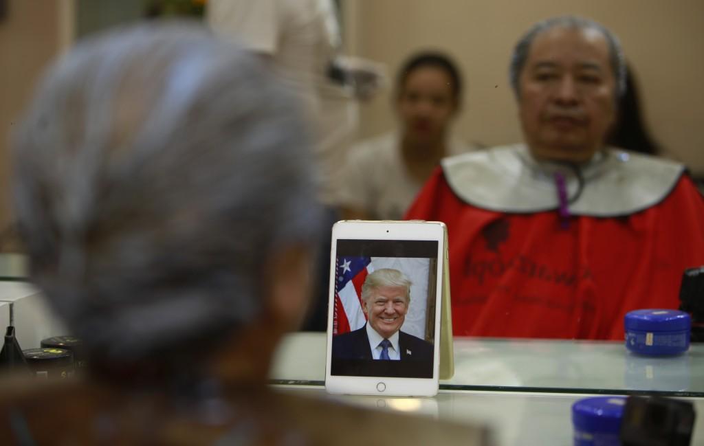 Le Phuc Hai, 66, receives a Trump haircut in Hanoi, Vietnam, on Tuesday, Feb. 19, 2019.   U.S. President Donald Trump and North Korean leader Kim Jong