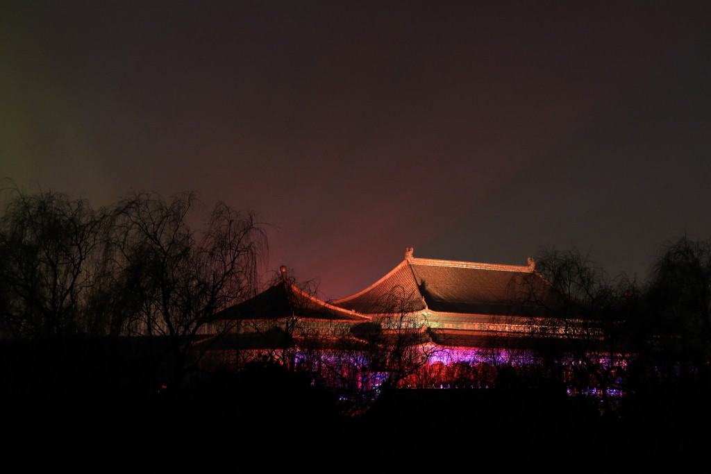 In this Tuesday, Feb. 19, 2019, photo, the Forbidden City is projected with colorful lights for the Lantern Festival in Beijing. China lit up the Forb