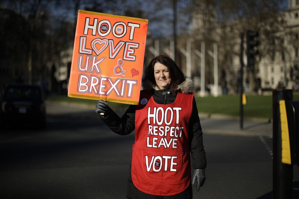Leave the European Union supporter Michelle Megan from Newbury and originally from Dublin, Ireland, poses for photographs opposite the Houses of Parli...