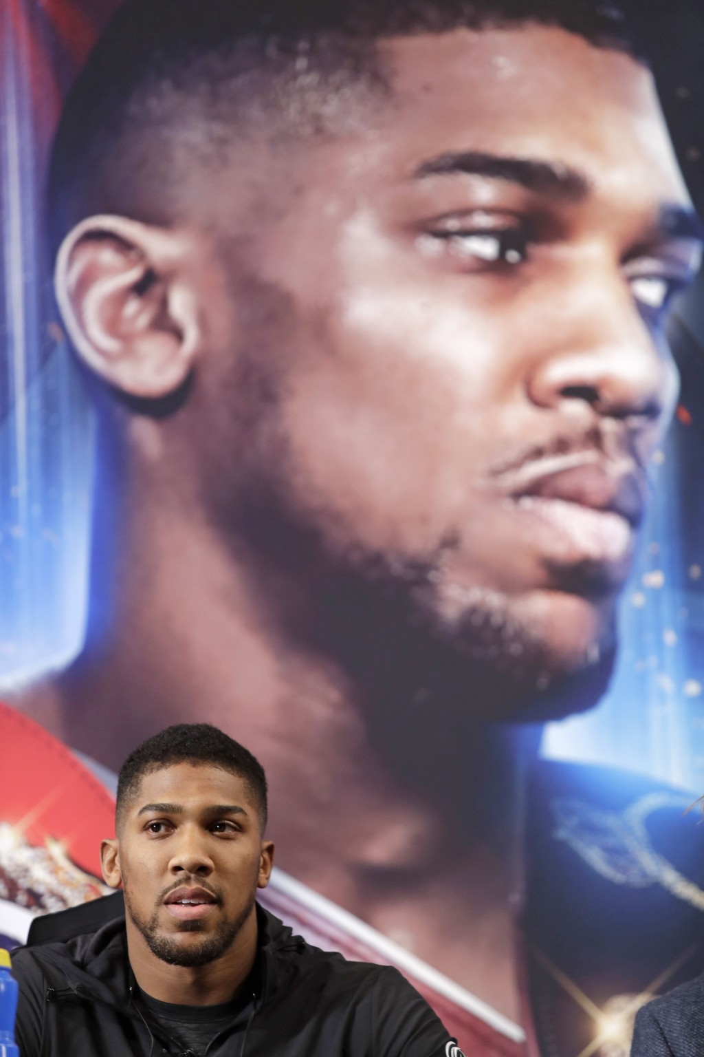 British boxer Anthony Joshua listens during a news conference, Tuesday, Feb. 19, 2019, in New York, to promote his upcoming fight against Jarrell Mill...