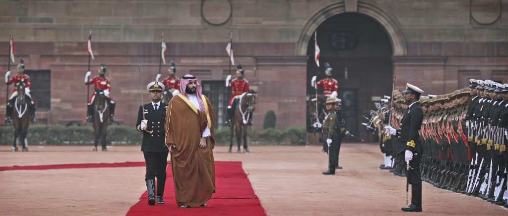 Saudi Arabia's Crown Prince Mohammed bin Salman inspects a joint military guard of honor upon his arrival at the Indian presidential palace for a cere