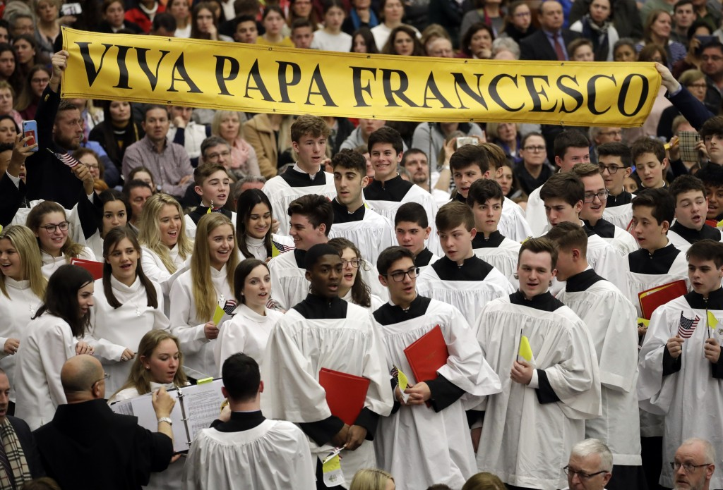 """Members if the choir of St. Anthony High School from New York show a banner reading """"up with Pope Francis"""" during the general audience in the Paul VI"""