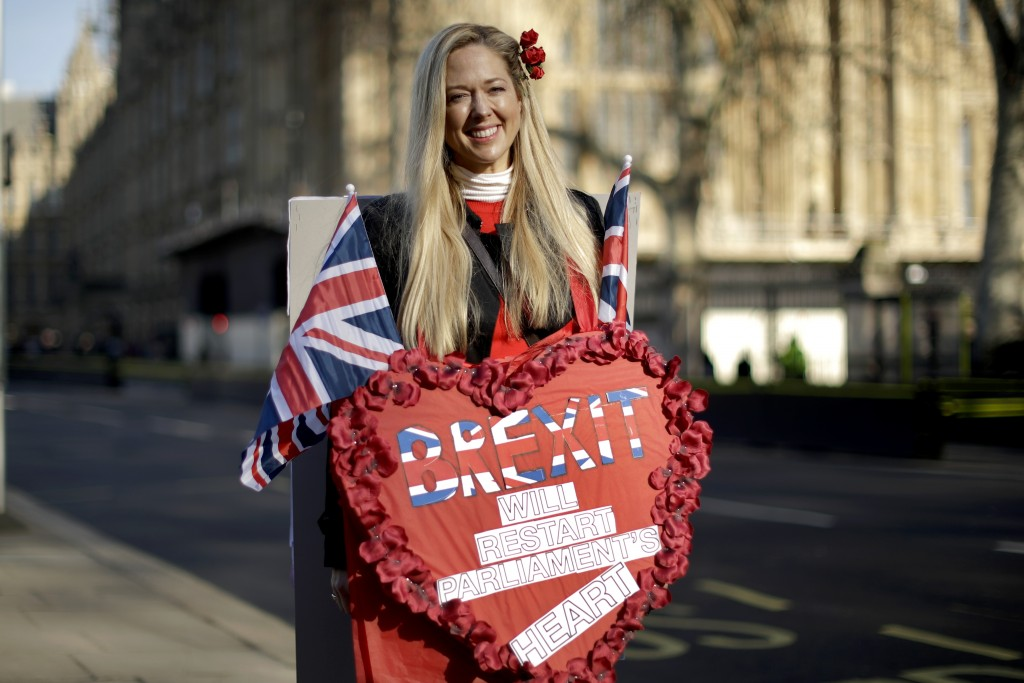 Leave the European Union supporter Belinda Delucy, aged 42 from London, poses for photographs backdropped by the Houses of Parliament in London, Thurs...
