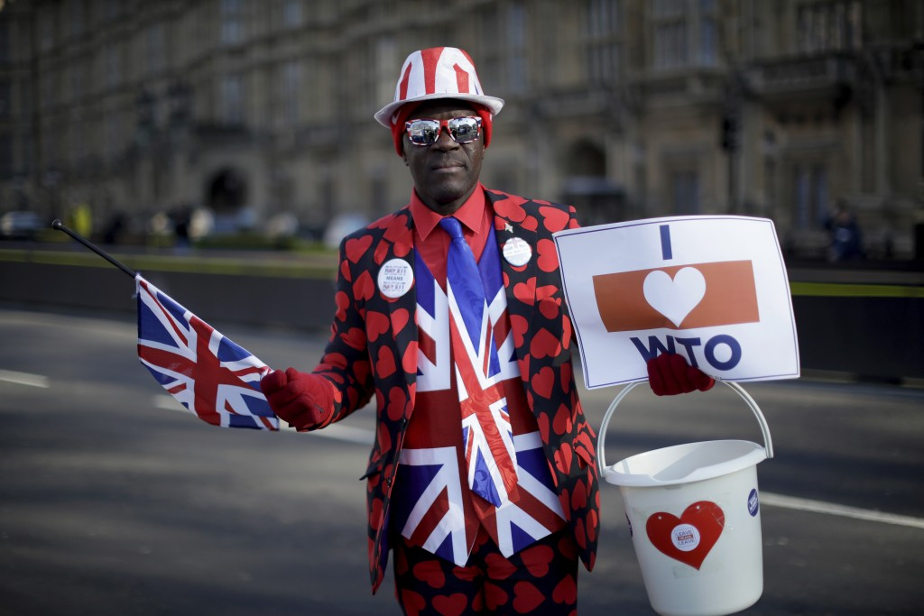 Leave the European Union supporter Joseph Afrane, aged 55 from London and originally from Ghana, poses for photographs outside the Houses of Parliamen...