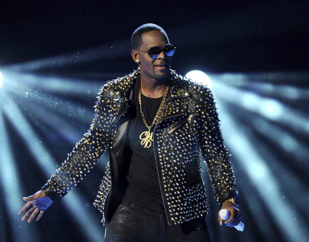 FILE - In this June 30, 2013 file photo, R. Kelly performs at the BET Awards in Los Angeles. Prosecutors will have to clear a series of high legal hur...
