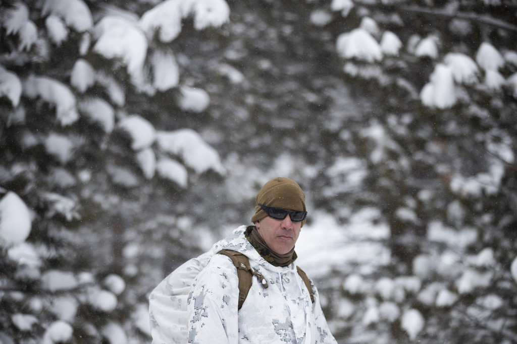 Maj. Gen. William F. Mullen, head of the Marine's Training and Education Command, listens to a debrief during advanced cold-weather training at the Ma...