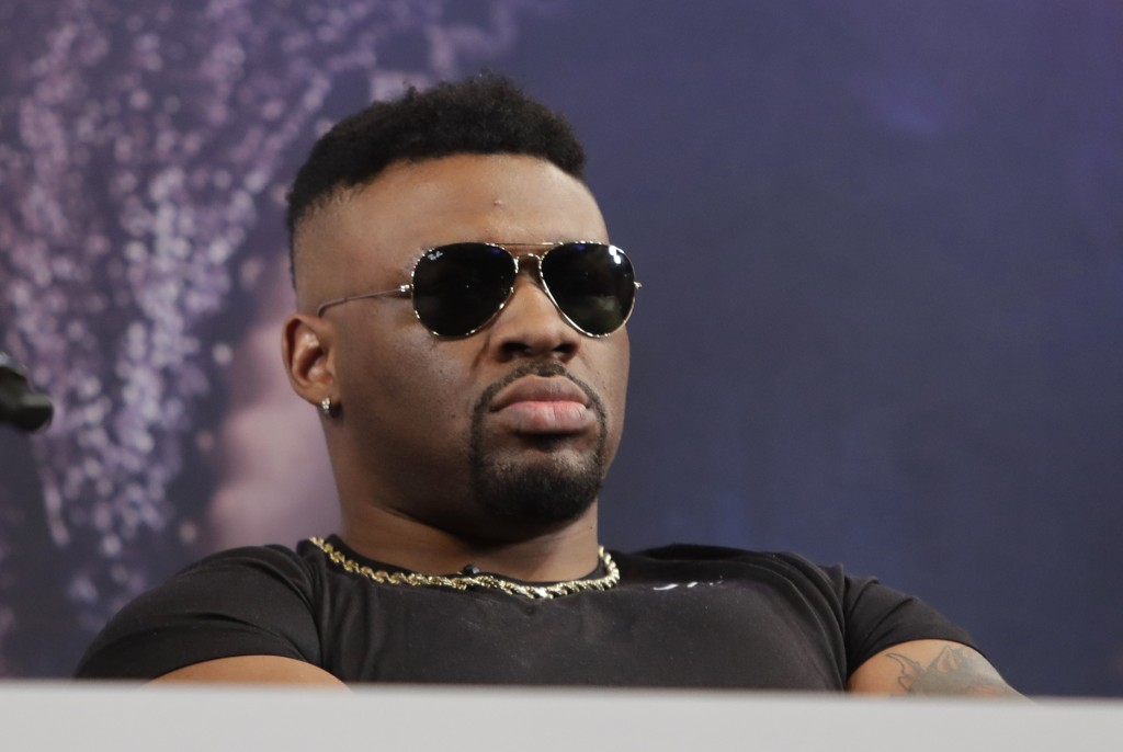 Boxer Jarrell Miller listens during a news conference Tuesday, Feb. 19, 2019, in New York, to promote his upcoming fight against British boxer Anthony...