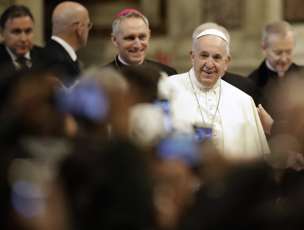 Pope Francis arrives in St. Peter's Basilica at the Vatican for a audience with pilgrims coming from the diocese of Benevento, Wednesday, Feb. 20, 201...