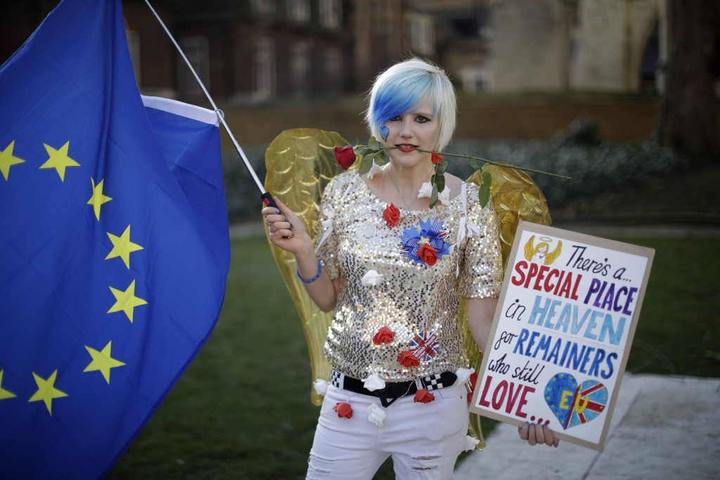 Remain in the European Union supporter Madeleina Kay, aged 24 from Sheffield, poses for photographs opposite the Houses of Parliament in London, Thurs...